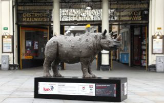 A Rhino named Watch Out and painted by Nancy Fouts. This Rhino is sponsored by Kabuto Noodles.