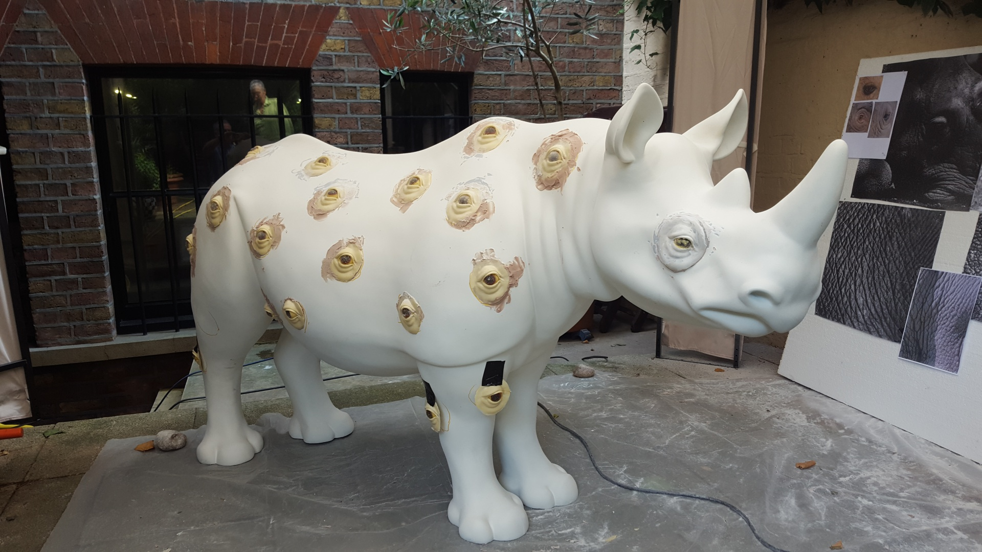 A Rhino named Watch Out and painted by Nancy Fouts. Work in Progress.